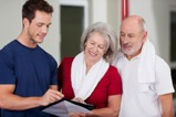 instructor showing results to sr couple.jpg